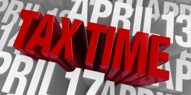 Wordart with Tax time written in red with Dates written in white around
