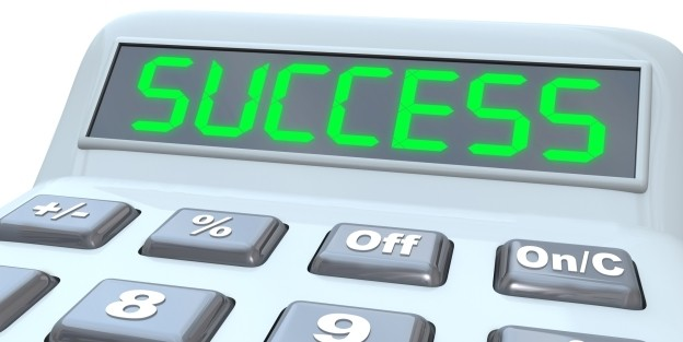 Calculator with the word success written in the digital screen