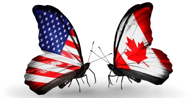Butterfly with american flag facing a butterfly with Canadian flag