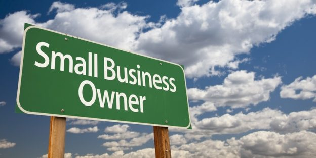 Green sign saying small business owners