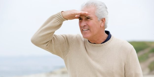 Older man on Beach Looking Out
