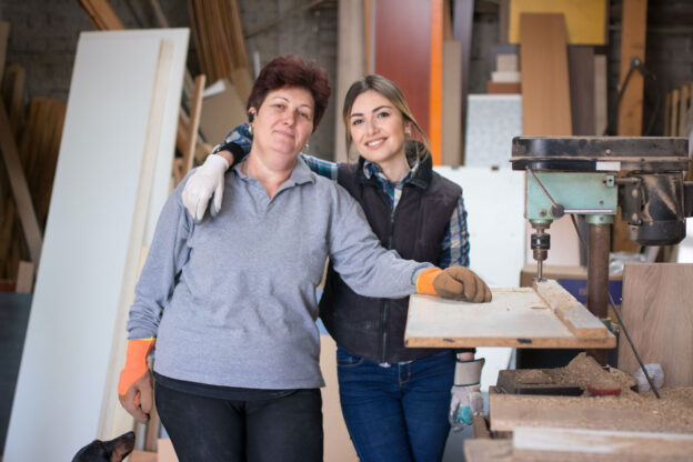 Mother and daughter at woodworking workshop